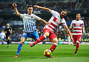 "MALAGA, SPAIN - DECEMBER 09:  Juan Pablo Anor ""Juanpi"" of Malaga CF (L) competes for the ball with David Rodriguez Lomban of Granada CF (R) during La Liga match between Malaga CF and Granada CF at La Rosaleda Stadium December 9, 2016 in Malaga, Spain.  (Photo by Aitor Alcalde Colomer/Getty Images)"