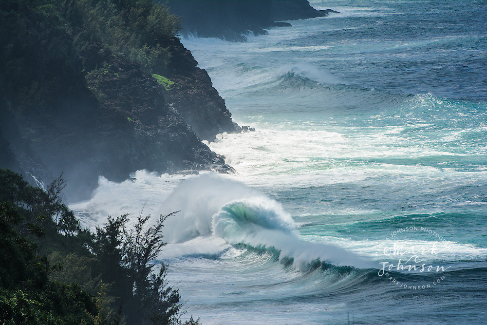 Large winter surf breaking off the Na Pali Coast of Kauai, Hawaii, USA