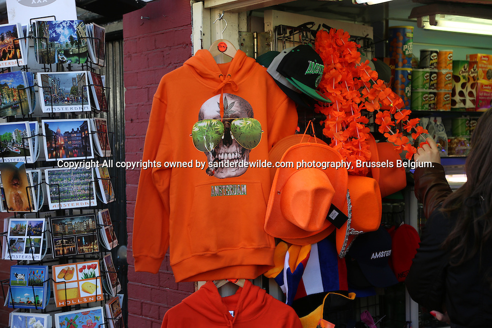29th April 2013 Amsterdam, Netherlands.Tomorrow Queen Beatrix' abdication takes place, and her son Prince Willem-Alexander will be King of the Netherlands. orange clothes and gadgets are everywhere for sale. A sweater promoting maruana, softdrugs