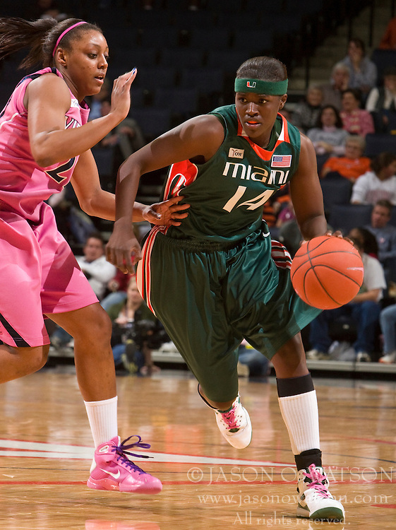 Miami (FL) guard/forward Charmaine Clark (14) is guarded by Virginia forward Monica Wright (22).  The #21 ranked Virginia Cavaliers defeated the Miami Hurricanes 85-74 in overtime at the John Paul Jones Arena in Charlottesville, VA on February 19, 2009.
