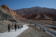 Tourists park their cars along the side of the highway to avoid incurring fines from speed tracking cameras in Golok region, Tibet (Qinghai, China).