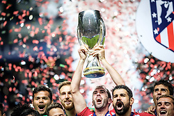 August 16, 2018 - Tallinn, Estonia - Diego Godin of Atletico Madrid celebrating with trophy at UEFA Super Cup 2018 in Tallinn..The UEFA Super Cup 2018 was played between Real Madrid and Atletico Madrid. Atletico Madrid won the match 4-2 during extra time after and took the trophy after drawing at 2-2 during the first 90 minute of game play. (Credit Image: © Hendrik Osula/SOPA Images via ZUMA Wire)