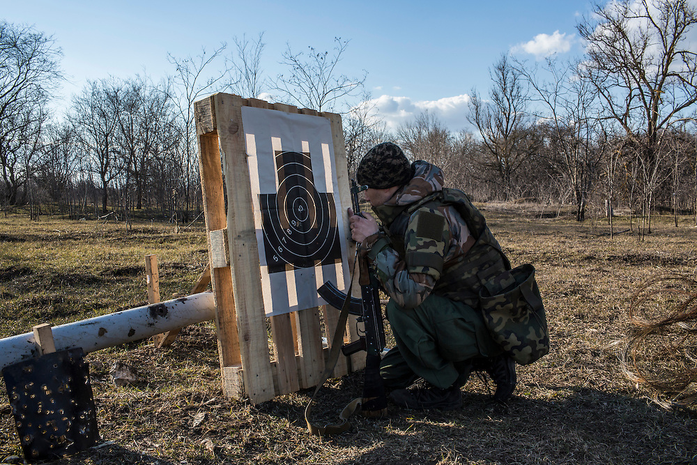 A member of the Azov Brigade inspects his marksmanship during weapons training at one of the group's training grounds on Saturday, March 7, 2015 in Kulykivske, Ukraine. Photo by Brendan Hoffman, Freelance
