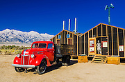 Red truck and mess hall at Manzanar National Historic Site, Lone Pine, California USA
