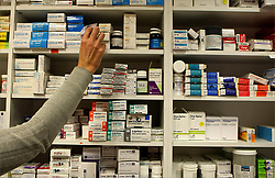 File photo dated 16/11/09 of drugs in a pharmacy, as more than a fifth of GP patients prescribed antibiotics for pneumonia fail to respond to the treatment, a major US study has shown.
