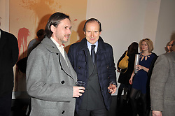 Left to right, MARC NEWSON and SIMON DE PURY at a private view of 'Engagement' an exhibition of new works by Jennifer Rubell held at the Stephen Friedman Gallery, 25-28 Old Burlington Street, London on 7th February 2011.