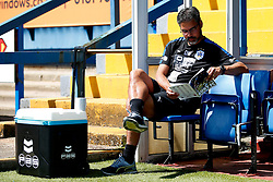 Huddersfield Town manager David Wagner reads the matchday programme in the dugout before kick off - Mandatory by-line: Matt McNulty/JMP - 16/07/2017 - FOOTBALL - Gigg Lane - Bury, England - Bury v Huddersfield Town - Pre-season friendly