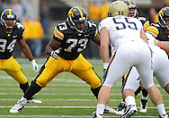 September 17, 2011: Iowa Hawkeyes offensive linesman Adam Gettis (73) prepares to block during the first half of the game between the Iowa Hawkeyes and the Pittsburgh Panthers at Kinnick Stadium in Iowa City, Iowa on Saturday, September 17, 2011. Iowa defeated Pittsburgh 31-27.