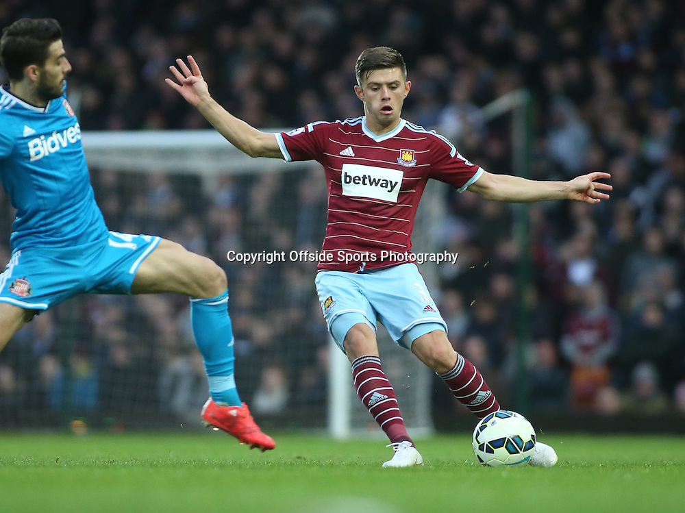 21 March 2015 - Barclays Premier League - West Ham United v Sunderland - Aaron Cresswell of West Ham makes a pass under pressure.<br /> <br /> Photo: Ryan Smyth/Offside