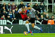 Jamaal Lascelles (#6) of Newcastle United knocks over Marcus Rashford (#10) of Manchester United as he wins possession of the ball during the Premier League match between Newcastle United and Manchester United at St. James's Park, Newcastle, England on 2 January 2019.