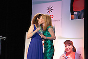 Jenni Luke, Executive Director, Step Up Women's Network, presents to honoree Susan Sweet, General Manager, Neutrogena