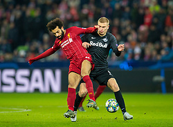 SALZBURG, AUSTRIA - Tuesday, December 10, 2019: Liverpool's Mohamed Salah (L) and FC Salzburg's Rasmus Kristensen during the final UEFA Champions League Group E match between FC Salzburg and Liverpool FC at the Red Bull Arena. (Pic by David Rawcliffe/Propaganda)