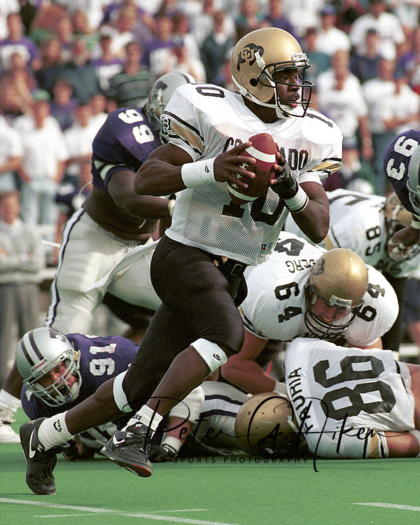 Colorado quarterback Kordell Stewart (10) rushes outside against Kansas State at KSU Stadium in Manhattan, Kansas in 1994.