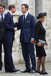 LONDON - UK - 11- SEPT - 2013: Britain's Prince Charles, The Prince of Wales,accompanied by Camilla, The Duchess of Cornwall and his sons Prince WIlliam and Prince Harry attend the funeral of Charles's close friend Hugh Van Cutsem at Brentwood Cathedral in Essex.<br /> The Van Cutsem sons meet the Royal family outside the service<br /> Photo by Ian Jones