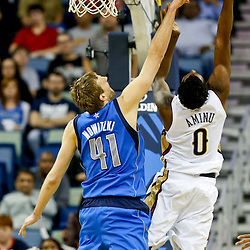Dec 4, 2013; New Orleans, LA, USA; New Orleans Pelicans small forward Al-Farouq Aminu (0) has a shot blocked by Dallas Mavericks power forward Dirk Nowitzki (41) during the second half of a game at New Orleans Arena.The Mavericks defeated the Pelicans 100-97. Mandatory Credit: Derick E. Hingle-USA TODAY Sports