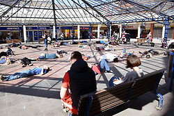 "Extinction Rebellion Norwich clean air ""die-in"" at Anglia Square to highlight high levels of pollution in parts of the city and promote Car Free Day. Anglia Square is at the centre of a controversial development debate. Norwich UK 14 September 2019"
