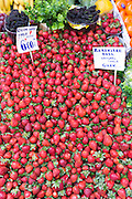 Fresh fruit strawberries with Turkish lira prices for sale at food market in Kadikoy district Asian side Istanbul, East Turkey