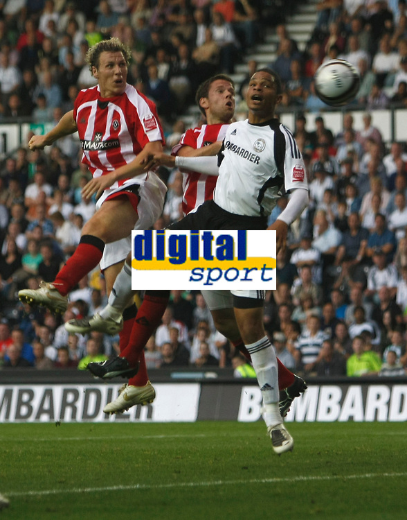 Photo: Steve Bond/Richard Lane Photography. Derby County v Sheffield United. Coca-Cola Championship. 13/09/2008. Darius Henderson (L) gets a late header in, in front of Dean Leacock (R)