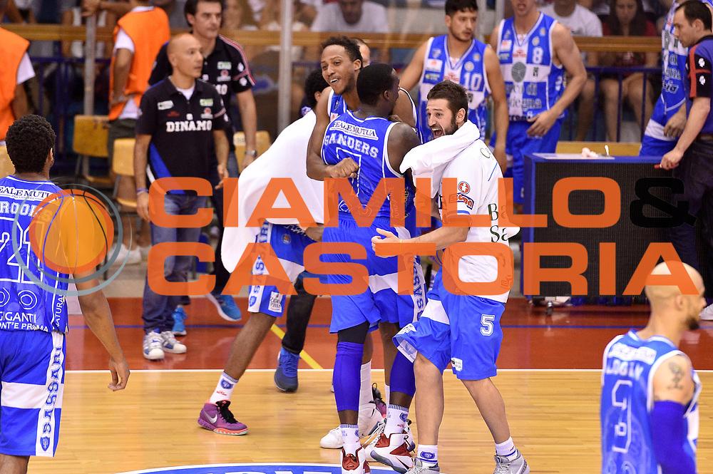 DESCRIZIONE : Campionato 2014/15 Serie A Beko Grissin Bon Reggio Emilia - Dinamo Banco di Sardegna Sassari Finale Playoff Gara7 Scudetto<br /> GIOCATORE : Kenny Kadji Sanders Rakim Matteo Formenti<br /> CATEGORIA : esultanza<br /> SQUADRA : Banco di Sardegna Sassari<br /> EVENTO : Campionato Lega A 2014-2015<br /> GARA : Grissin Bon Reggio Emilia - Dinamo Banco di Sardegna Sassari Finale Playoff Gara7 Scudetto<br /> DATA : 26/06/2015<br /> SPORT : Pallacanestro<br /> AUTORE : Agenzia Ciamillo-Castoria/GiulioCiamillo<br /> GALLERIA : Lega Basket A 2014-2015<br /> FOTONOTIZIA : Grissin Bon Reggio Emilia - Dinamo Banco di Sardegna Sassari Finale Playoff Gara7 Scudetto<br /> PREDEFINITA :