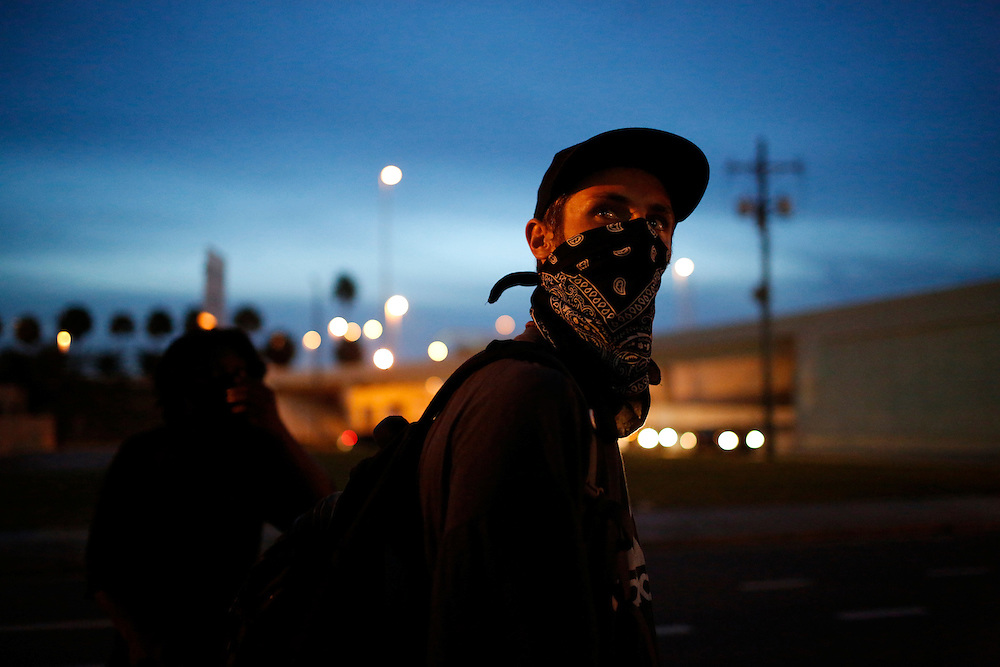 Protesters using Black Bloc tactics march through the streets of Tampa, Fla. during the 2012 Republican National Convention on August 29, 2012. The demonstrators took sandwiches to the homeless, picked up trash off of the street and spoke out against police brutality.