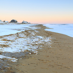Snow on the beach after a winter storm on Plum Island in Newburyport, Massachusetts.