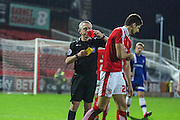 Swindon Town's captain Raphael Rossi Branco receives a red card during the Sky Bet League 1 match between Swindon Town and Gillingham at the County Ground, Swindon, England on 26 December 2015. Photo by Shane Healey.