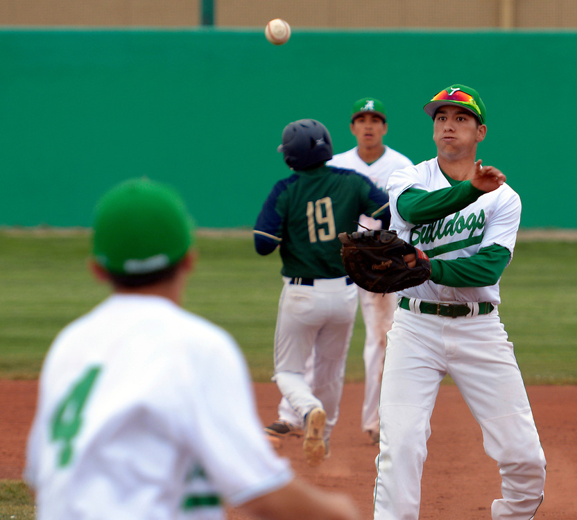 gbs041117g/SPORTS -- Albuquerque High's first baseman Benito Castillo throws to pitcher Robby Herrera, 4, for the out in the second inning of the game against Atrisco Heritage at Albuquerque High on Tuesday, April 11, 2017.(Greg Sorber/Albuquerque Journal)