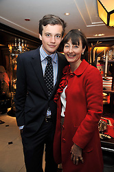 FREDDIE COLERIDGE and his mother GEORGIE COLERIDGE at a signing of Redeeming Features - Nicky Haslam's autobiography hosted by House & Garden magazine held at Ralph Lauren, Bond Street, London on 29th October 2009.