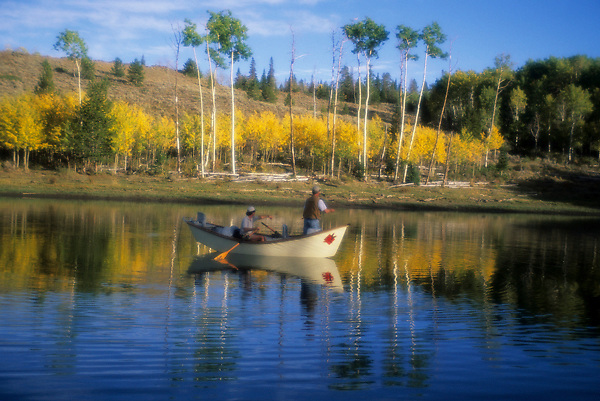 Stock photo of a couple fishing from their canoe on the lake