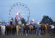 Augusta, New Jersey - Cowboys and cowgirls wait for their turn during the team penning competition at the New Jersey State Fair and Sussex County Farm and Horse Show on Aug. 11, 2010.
