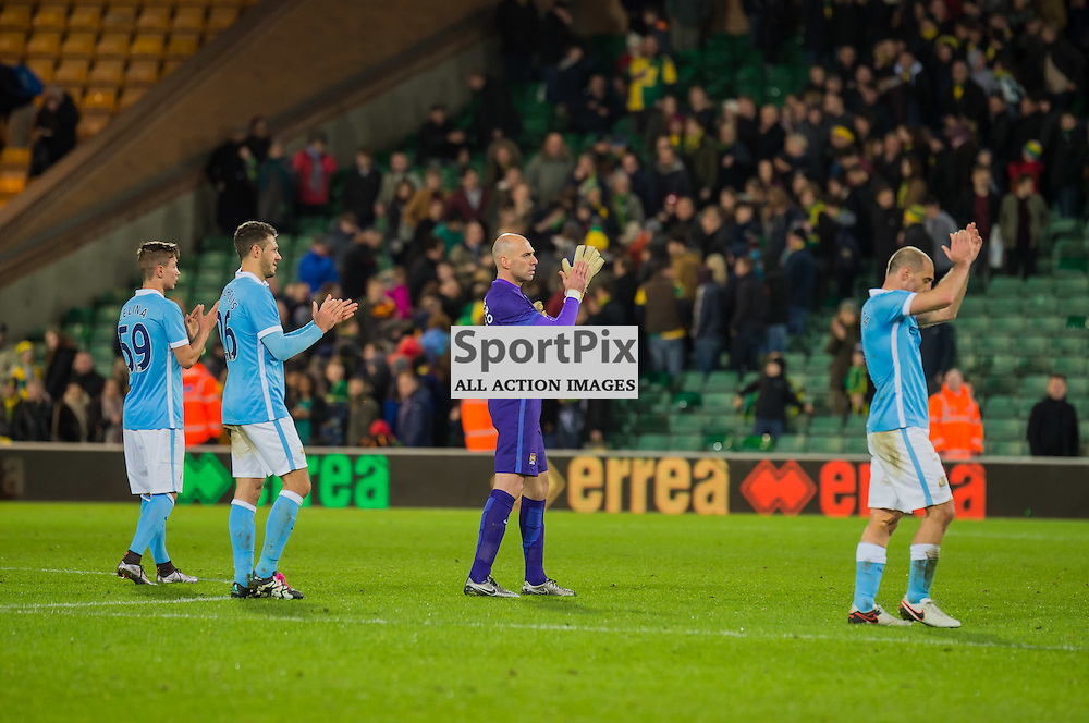 Victors Manchester City players salute their travelling supporters after the 3-0 3rd round FA cup win against Norwich City at Carrow Road