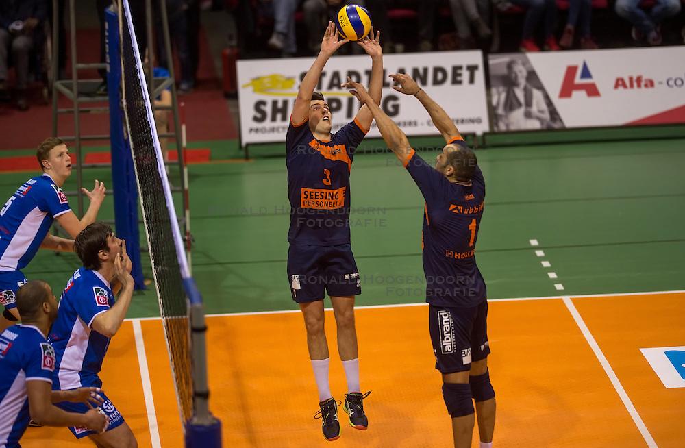 17-04-2016 NED: Play off finale Abiant Lycurgus - Seesing Personeel Orion, Groningen<br /> Abiant Lycurgus is door het oog van de naald gekropen tijdens het eerste finaleduel om het landskampioenschap. De Groningers keken in een volgepakt MartiniPlaza tegen een 0-2 achterstand aan tegen Seesing Personeel Orion, maar mede dankzij invaller Gino Naarden kwam Lycurgus langszij en pakte het de wedstrijd met 3-2 / Ryan Anselma #1 of Orion, Stijn Held #3 of Orion