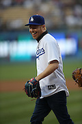 LOS ANGELES, CA - AUGUST 22:  Actor  Jesse Tyler Ferguson, co-star of the comedy television series Modern Family, laughs after throwing out the celebratory first pitch before the Los Angeles Dodgers game against the New York Mets at Dodger Stadium on Friday, August 22, 2014 in Los Angeles, California. The Dodgers won the game 6-2. (Photo by Paul Spinelli/MLB Photos via Getty Images) *** Local Caption *** Jesse Tyler Ferguson