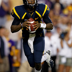 Sep 25, 2010; Baton Rouge, LA, USA; West Virginia Mountaineers quarterback Geno Smith (12) looks to pass against the LSU Tigers during the first half at Tiger Stadium.  Mandatory Credit: Derick E. Hingle