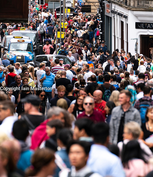 Edinburgh, Scotland, UK; 5 August, 2018. Edinburgh Fringe Festival's first weekend sees thousands of tourists and locals on the Royal Mile  enjoying the free street performers. Pictured; Crowded streets at top of Royal Mile.