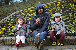 © Licensed to London News Pictures. 18/02/2016. Leeds, UK. The Brown family enjoy ice-creams despite the cold temperatures at Roundhay Park in Leeds, West Yorkshire. Forecasters are predicting temperatures to drop below zero this week as snow and ice are set to batter Britain. Photo credit : Ian Hinchliffe/LNP