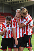 Danny Wright celebrates his penalty during the Vanarama National League match between Cheltenham Town and Dover Athletic at Whaddon Road, Cheltenham, England on 12 September 2015. Photo by Antony Thompson.