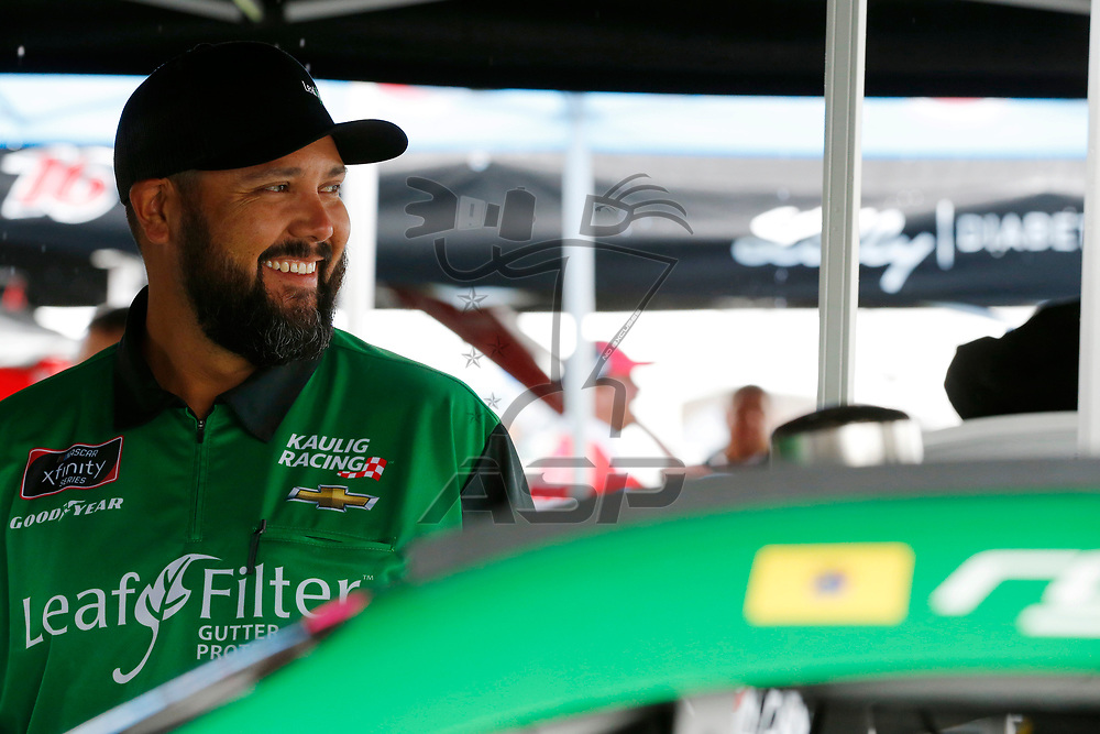 Ryan Truex (11) works in the garage during practice for the Zippo 200 at Watkins Glen International in Watkins Glen, New York.