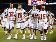 DENVER, CO - JULY 4: Boston Cannons teammates Martin Bowes #12, Ryan Tucker #16, Chad Wiedmaier #45 and Adam Ghitelman #15 celebrate their victory over the Denver Outlaws while walking off the field after their MLL game at Sports Authority Field at Mile High on July 4, 2015 in Denver, Colorado. The Cannons won the game 22-9. (Photo by Marc Piscotty/Getty Images) *** Local Caption *** Martin Bowes, Ryan Tucker, Chad Wiedmaier, Adam Ghitelman