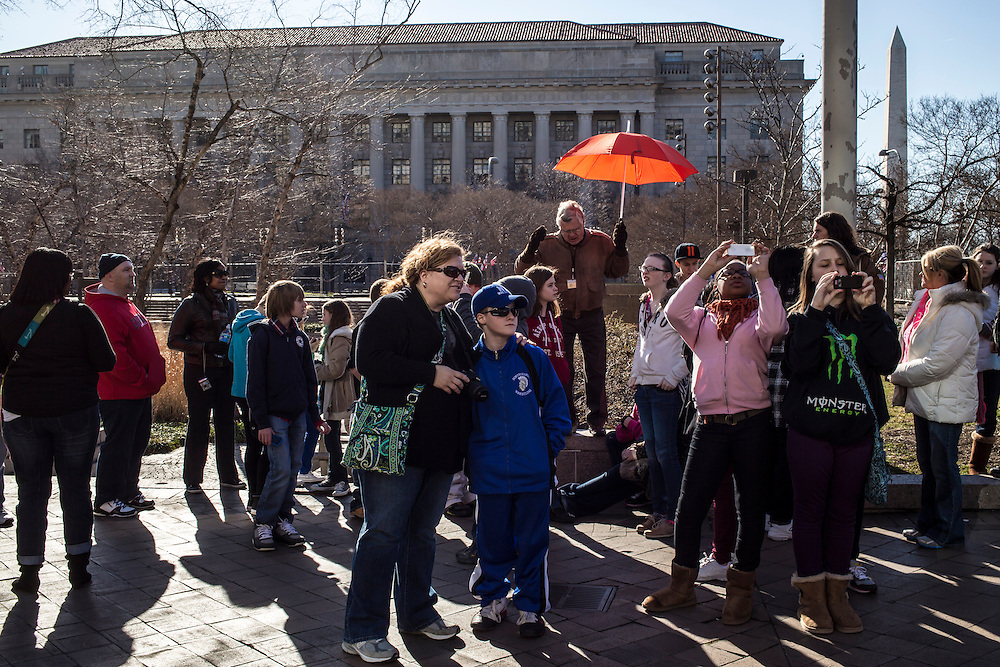 People participate in a tour of Washington on Sunday, January 20, 2013 in Washington, DC.