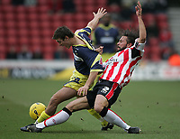 Photo: Lee Earle.<br /> Southampton v Derby County. Coca Cola Championship. 04/02/2006. Derby's Lee Holmes (L) battles with Alexander Ostlund.