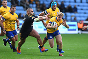 Bath scrum half Chris Cook (9) escapes the tackle of Wasps prop wasps Zurabi Zhvania (1) during the Gallagher Premiership Rugby match between Wasps and Bath Rugby at the Ricoh Arena, Coventry, England on 2 November 2019.
