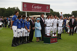 Queen Elizabeth II with winning team La Indiana at the end of the Cartier Trophy at the Guards Polo Club, Windsor Great Park, Surrey.