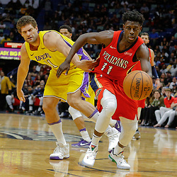 Feb 14, 2018; New Orleans, LA, USA; New Orleans Pelicans guard Jrue Holiday (11) steals the ball from Los Angeles Lakers center Brook Lopez (11) during the second half at the Smoothie King Center. The Pelicans defeated the Lakers 139-117. Mandatory Credit: Derick E. Hingle-USA TODAY Sports