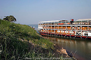 A river boat carrying visiting tourists is docked at the shore of the Mekong River in Kampong Cham, Cambodia.