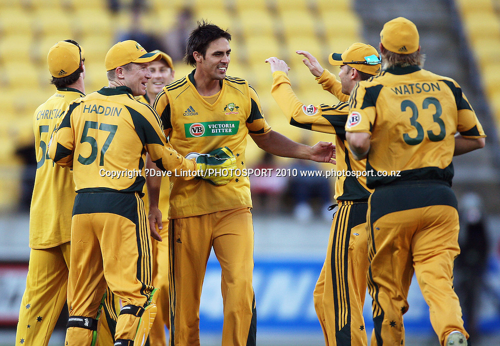 Australia's Mitchell Johnson is congratulated by his teammates after dismissing Peter Ingram.<br /> 1st Twenty20 cricket match - New Zealand v Australia at Westpac Stadium, Wellington. Friday, 26 February 2010. Photo: Dave Lintott/PHOTOSPORT