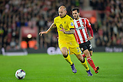 Aston Villas Alan Hutton and Southamptons Juanmi during the Capital One Cup match between Southampton and Aston Villa at the St Mary's Stadium, Southampton, England on 28 October 2015. Photo by Adam Rivers.