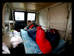 19th Feb, 2006. New Orleans, Louisiana. A man named Kenneth. Living in the back of a broken down van in the parking lot of the still closed Winn Dixie supermarket parking lot close to the French Quarter. Kenneth took over the mattress which he found in the van. He came from Monroe, Louisiana looking for work, but spends most of his days listening to his small portable radio. He tries to keep a low profile, careful not to alert the police to his temporary home for fear of being moved on. The Salvation army have a soup kitchen nearby where he gets his food each day.