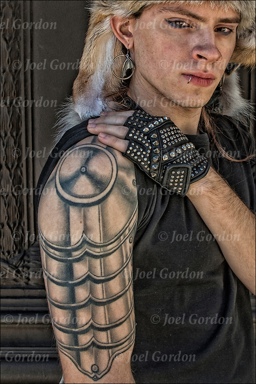 Stanislav Mass plate &quot;Plate Armor on tattoo sleeve, wearing coyote head piece.<br /> <br /> Body art or tattoos has entered the mainstream it is no longer considered a weird kind of subculture.<br /> <br /> &quot;According to a 2006 Pew survey, 40% of Americans between the ages of 26 and 40 have been tattooed&quot;.