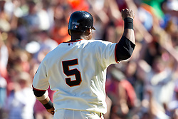 May 30, 2010; San Francisco, CA, USA;  San Francisco Giants shortstop Juan Uribe (5) scores the game winning run against the Arizona Diamondbacks during the tenth inning inning at AT&T Park.  San Francisco defeated Arizona 6-5 in 10 innings.